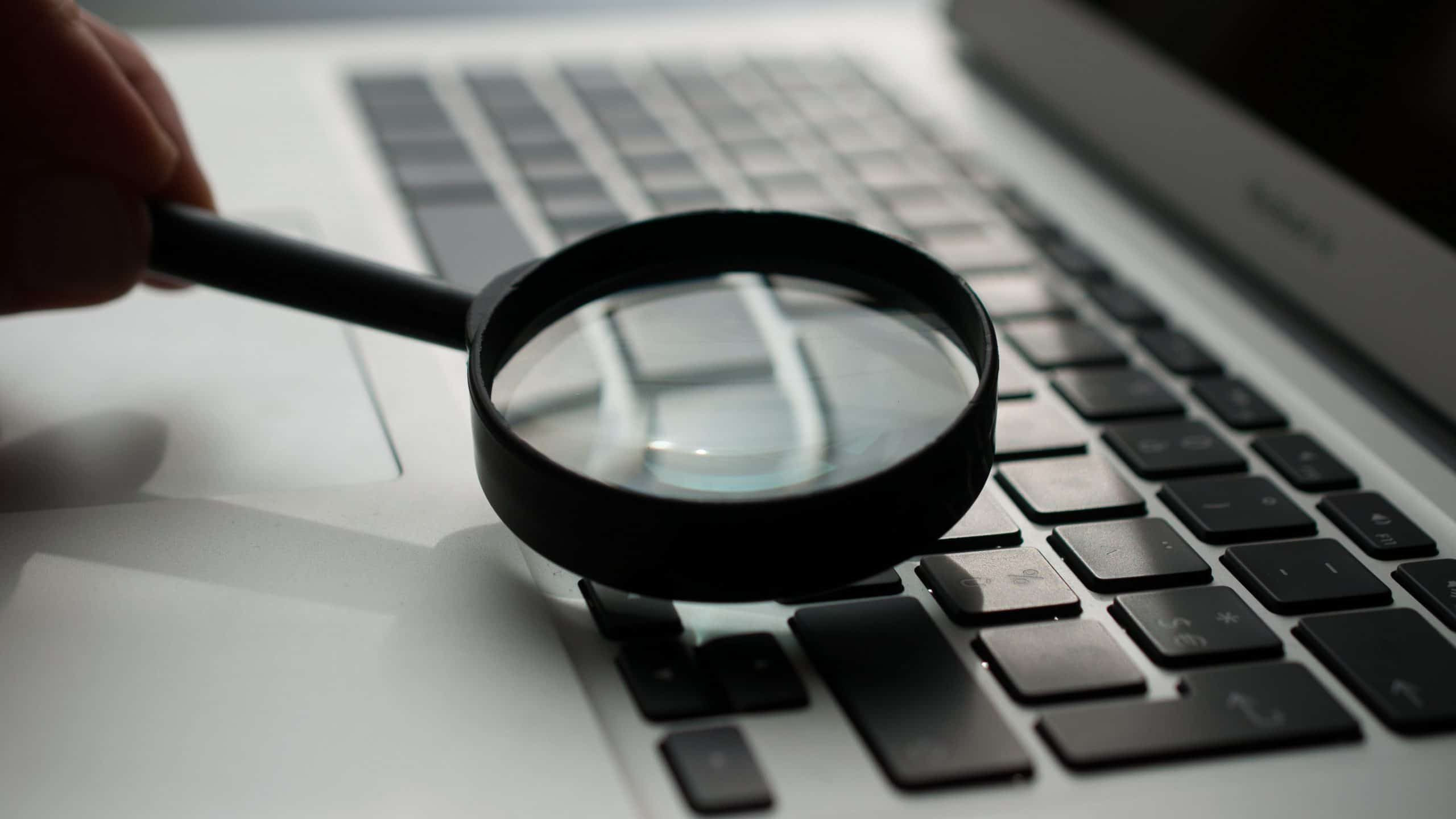 Magnifing Glass spying laptop